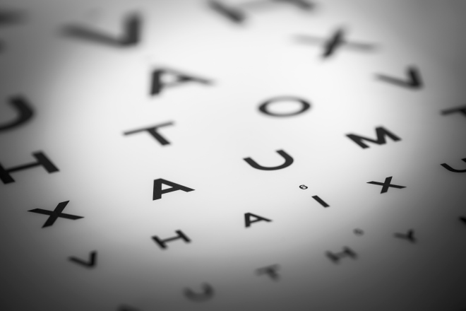 Opticians sight chart under a pool of bright light